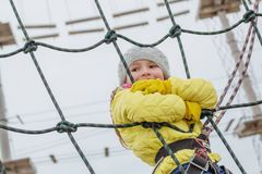 Little child on the obstacle course. In the adventure park Stock Photography