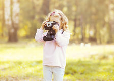 Little child with old retro camera doing photo Royalty Free Stock Photography