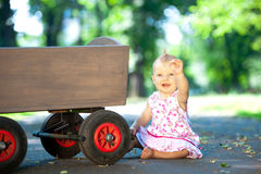 Little child and old wagon trolley Stock Photography