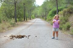 Free Little Child On The Way Surprised And Laughing At Horse Droppings Royalty Free Stock Photo - 180614925
