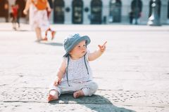 Little child outdoors in a italian european town. royalty free stock image