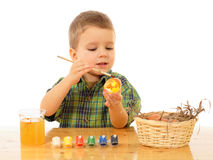 Little child painting the easter eggs Stock Photo