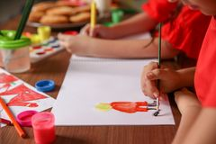 Little child painting picture at home royalty free stock photography