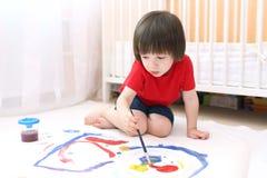 Little child paints Stock Photography