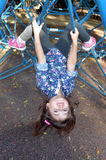 Little child paly on spider web bar in outdoor playground Stock Photo