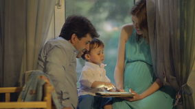 Little child and parents with pad at home stock footage