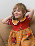 The little child with phone Stock Photo