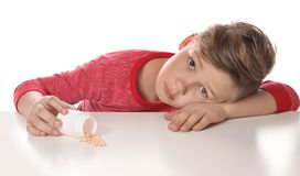 Little child with pills. Danger of medicament intoxication. Little child with pills on white background. Danger of medicament intoxication royalty free stock image