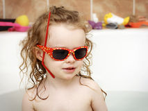 Little child plaing in the bath Stock Images