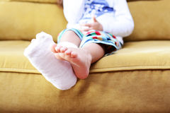 Little child with plaster bandage on leg heel fractured. Little child with a fractured ankle and a cast on her leg Royalty Free Stock Image