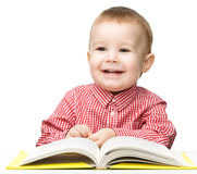Little child play with book Stock Images
