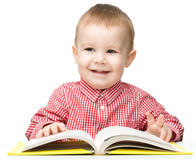 Little child play with book Stock Photo