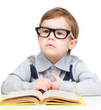 Little child play with book Royalty Free Stock Images