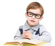 Little child play with book Royalty Free Stock Photography