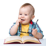 Little child play with book and glasses Royalty Free Stock Image