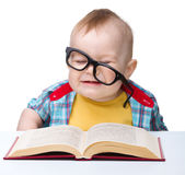 Little child play with book and glasses Stock Photo