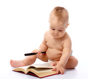 Little child play with book and magnifier Stock Images