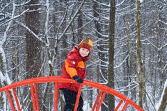 Little child on a playground on a snowy day Stock Images