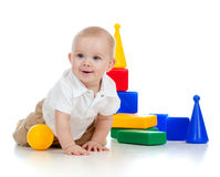 Little child playing with building blocks. Little boy playing with building blocks royalty free stock images