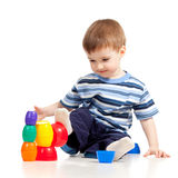 Little child is playing with color toys Stock Photography