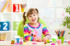 Little child playing with colorful clay. Little child girl playing with colorful clay Royalty Free Stock Photo