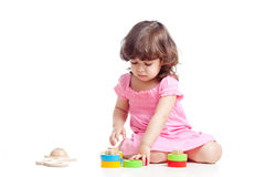 Little child playing with colorful toys Royalty Free Stock Image