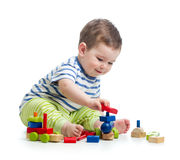 Little child playing with construction set Stock Photo