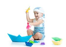 Little child playing with fishing rod toy. Child boy playing with toy fishing rod isolated Royalty Free Stock Images