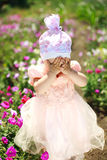 Little child playing in flowers field Royalty Free Stock Image