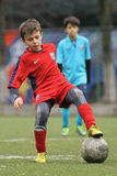 Little child playing football or soccer Royalty Free Stock Image