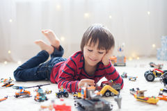 Little child playing with lots of colorful plastic toys indoor Royalty Free Stock Photography