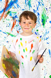 Little child playing with painting Royalty Free Stock Photos
