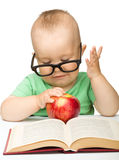 Little child is playing with red apple Stock Image