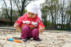 Little Child Playing with Sand. On the Beach Stock Photography