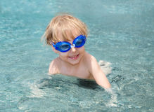 Little child playing in the sea Stock Photography
