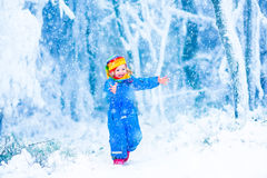 Little child playing in snow Stock Image