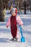 Little child playing on the street in winter. Little child is playing in the park in winter Stock Photography