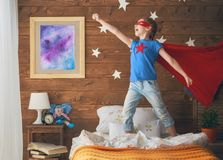 Child playing superhero. Little child playing superhero in the kids room. Girl power concept Stock Images