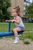 Little child playing on teeter Royalty Free Stock Images