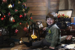 Little child playing with toys in a room with christmas decorati Royalty Free Stock Photos