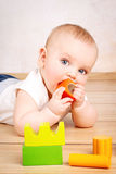 Little child playing with wooden bricks Stock Photo