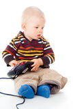 Little child plays with a joystick Royalty Free Stock Image