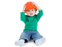 Little child plays with orange construction Stock Photo