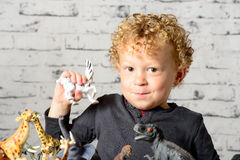 A little child plays with toys Stock Images