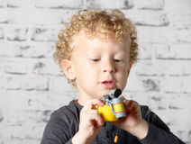 A little child plays with toys Royalty Free Stock Images