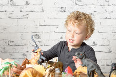 A little child plays with toys Stock Image