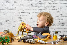 A little child plays with toys animals Stock Photo