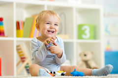 Little child plays with toys animals Royalty Free Stock Photo