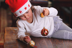 Little child plays with xmas tree decoration Royalty Free Stock Photography