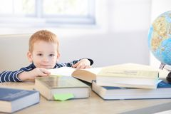 Little child prodigy learning at home smiling Royalty Free Stock Images